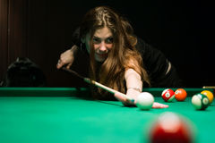 Woman for billiard table Royalty Free Stock Photography