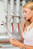 Woman with billing of heating costs for heating Stock Image