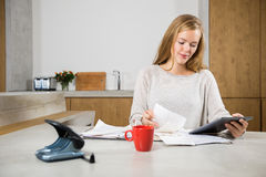 Woman With Bills And Digital Tablet At Table royalty free stock photography