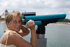 Woman on binocular Royalty Free Stock Images