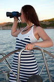 Woman with binocular Royalty Free Stock Photo
