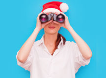 Woman with binocular and hat Stock Photography