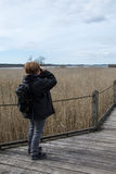 Woman with binocular 1. Woman studying birds with binocular, at lake Krankesjon, in Southern Sweden royalty free stock photos