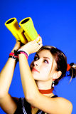 Woman with Binoculars. Woman looking through yellow binoculars stock photo