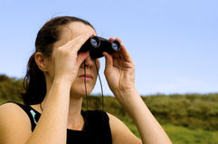 Woman With Binoculars Stock Photography