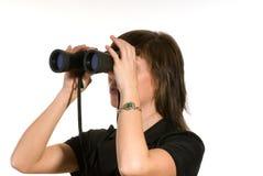 Woman with binoculars Stock Photography
