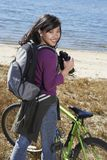 Woman With Binoculars At The Beach. Portrait of a young Asian women with binoculars at the beach Stock Images