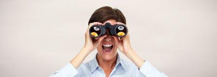 Woman with binoculars. Beautiful smart business woman portrait with binoculars Royalty Free Stock Images