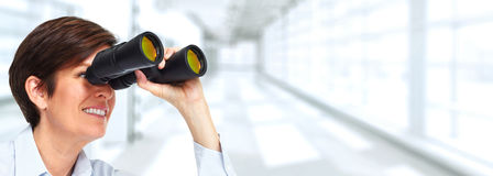 Woman with binoculars. Beautiful smart business woman portrait with binoculars Royalty Free Stock Images