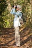 woman binoculars bird watching Stock Image
