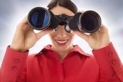 Woman with binoculars Royalty Free Stock Photo