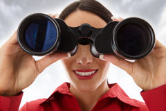 Woman with binoculars Stock Images