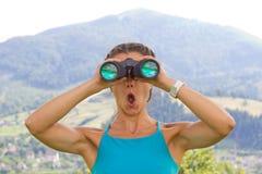 Woman binoculars Stock Images