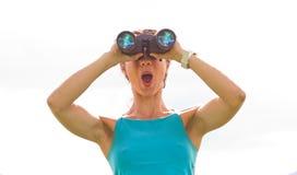 Woman binoculars Stock Image