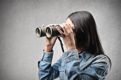 Woman with a binoculars Royalty Free Stock Photos