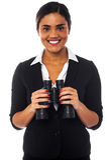 Woman with binoculars looking at you Stock Photos