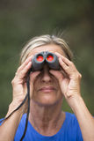 Woman with binoculars in nature outdoor Stock Image