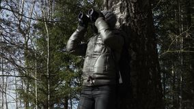 Woman with binoculars watching nature. Stock footage video stock video