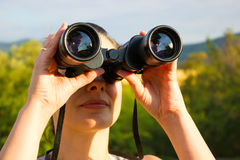 Woman with binoculars Royalty Free Stock Image