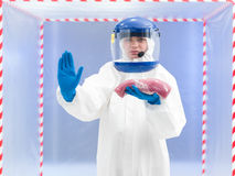Woman in a biohazard suit with a meat sample Stock Photography
