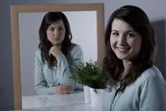 Woman with bipolar personality disorder. Lonely young woman with bipolar personality disorder stock photo