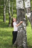 The woman and a birch Royalty Free Stock Photos