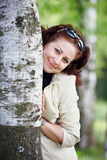 Woman with a birch Stock Photo