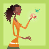 Woman and bird. African american woman holding a flower with a bird flying over it Royalty Free Stock Photo