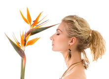 Woman with bird of paradise Royalty Free Stock Image