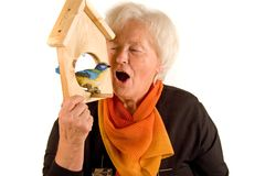Woman with birdhouse Royalty Free Stock Photography