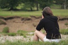 Woman birdwatching. For Sandmartins Royalty Free Stock Image