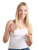 Woman with birth control pills Royalty Free Stock Photos