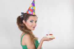 Woman in a Birthday Cap blowing the Candle on Cake Stock Photos
