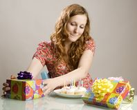 Woman with birthday gifts Stock Photo