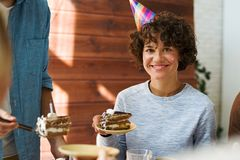 Woman at birthday party Royalty Free Stock Image