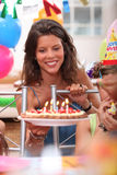 Woman at birthday party Stock Photo