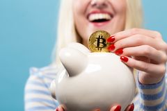 Woman with bitcoin and piggy bank Royalty Free Stock Image