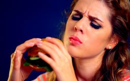 Woman bite hamburger fast food. stock images