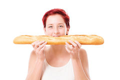 Woman bites in baguette from side Royalty Free Stock Photography