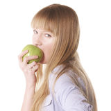 Woman biting apple Stock Images
