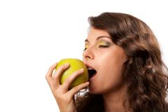 Woman biting apple Royalty Free Stock Photography