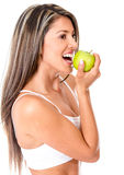 Woman biting an apple Royalty Free Stock Image