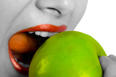 Woman biting apple Royalty Free Stock Images