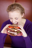 Woman Biting Big Burger Royalty Free Stock Photography