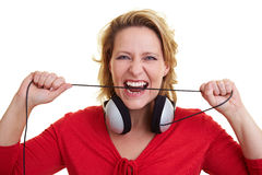 Woman biting in cable Royalty Free Stock Photos