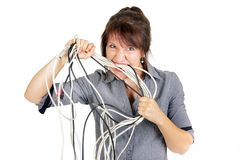 Woman biting cables Royalty Free Stock Photo