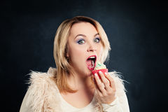 Woman Biting Cake. Model with Unhealthy Food Stock Image