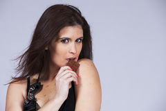 Woman biting chocolate Stock Photography
