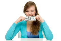 Woman biting dollar bill. Young woman over white background Royalty Free Stock Images