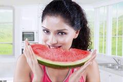 Woman biting fresh watermelon Royalty Free Stock Image